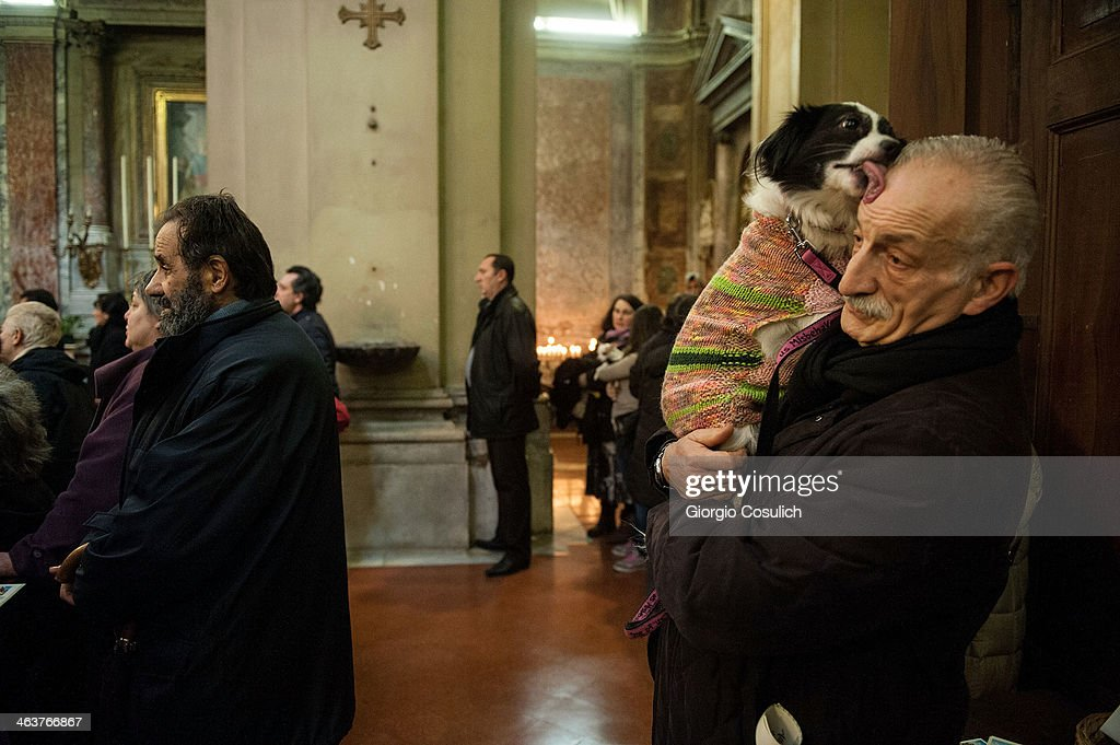 A dog and its owner attend a traditional mass for the blessing of animals at the Sant'Eusebio church on January 19, 2014 in Rome, Italy. Every year during the feast of St. Anthony the Abbot animals are blessed in countries around the world.