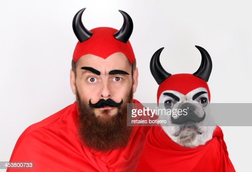 Dog and man dressed demons