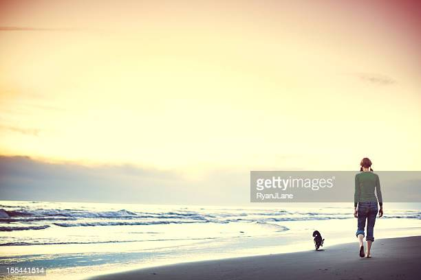 Dog and Woman At Oregon Coast