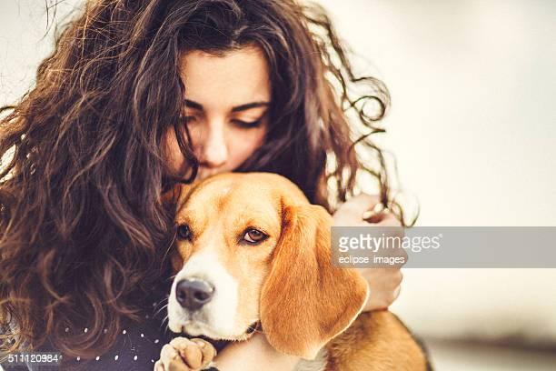 Cachorro e mulher