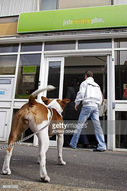 A dog awaits its owner outside the Job Centre in Chatham in southeast England on March 19 2009 Recessionhit Britain took a fresh blow Wednesday as...