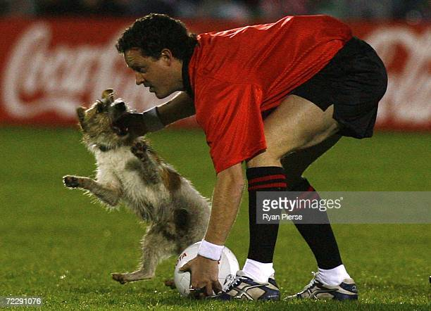A dog bites the hand of Umpire Shane McInerney of Australia during the International Rules First Test between Ireland and Australia at Pearse Stadium...