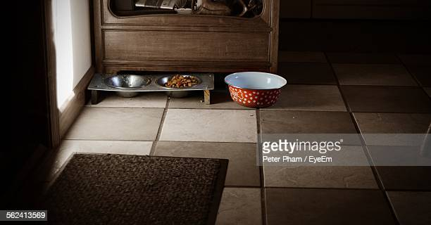 Dog Food In Bowl On Tiled Floor