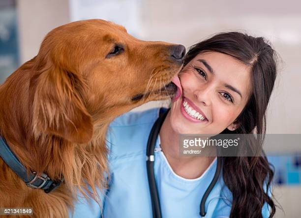 Dog giving kiss to the vet