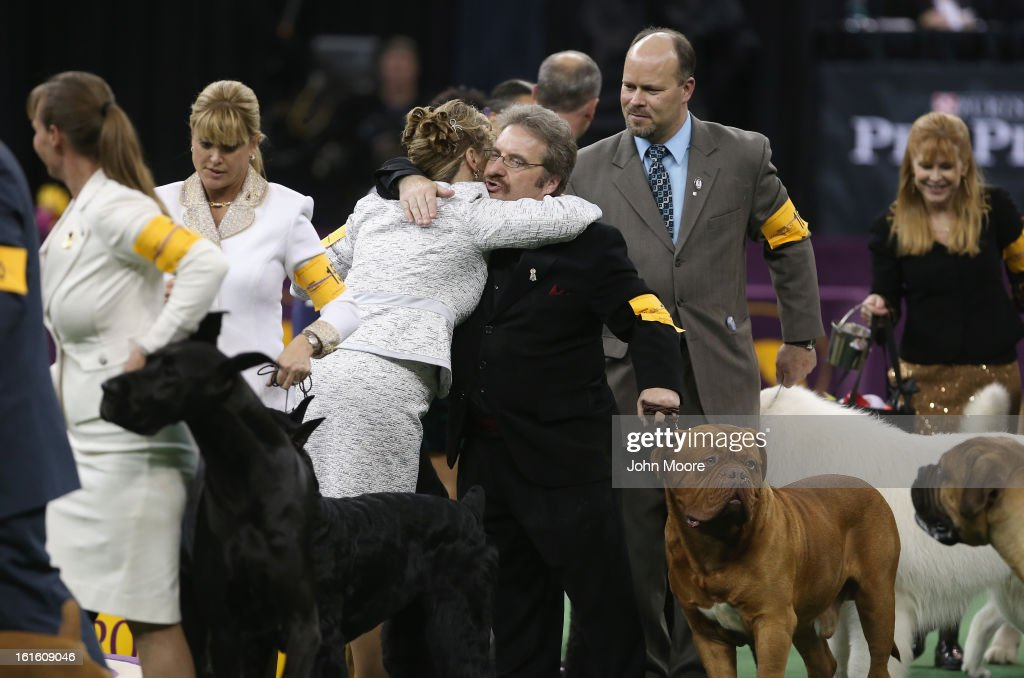 Dog handlers embrace after the 137th Westminster Kennel Club Dog Show on February 12, 2013 in New York City. A total of 2,721 dogs from 187 breeds and varieties competed in the event, hailed by organizers as the second oldest sporting competition in America, after the Kentucky Derby.