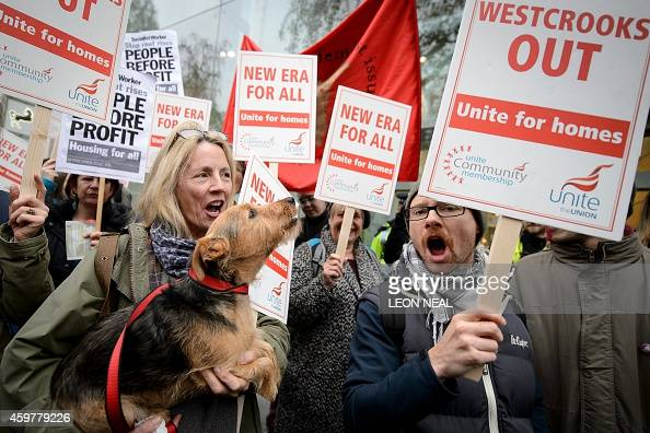 A dog howls as New Era housing estate tenants and their supporters gather in central London on December 1 before marching against plans to evict them...