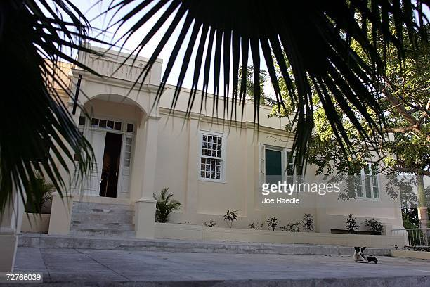 A dog lays in front of Finca VigIia or 'Lookout Farm' his home from 1939 to 1960 December 4 2006 in Havana Cuba Built in 1886 on a hillside the home...