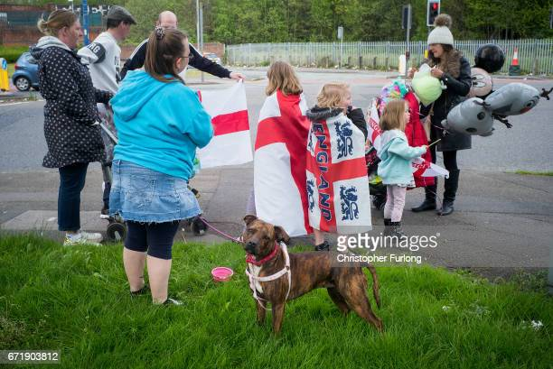 A dog looks on as families and local residents watch the Manchester St George's Day parade through the streets on April 23 2017 in Manchester England...