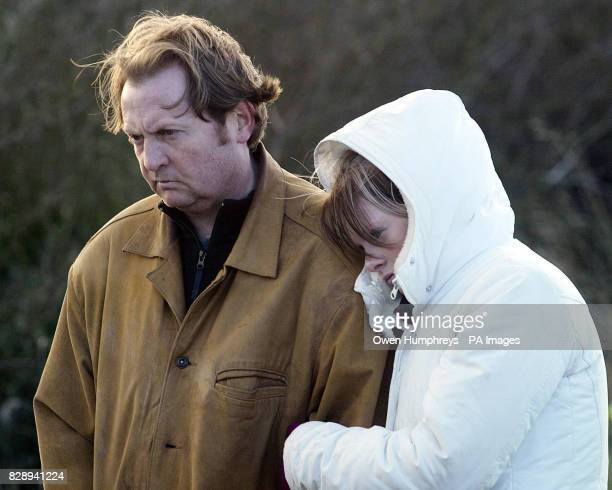 Dog owner John Pervival and daughter Helen look on in despair as firemen called off the painstaking search for Sasha their 12weekold Staffordshire...
