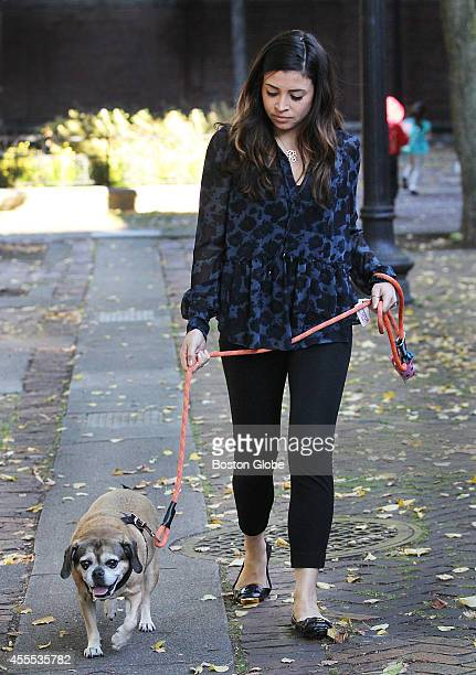 Dog sitter Rachel Askew and Fenway took a walk through Paul Revere Mall in Boston's North End Friday September 12 2014