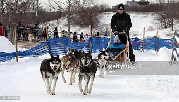 Dog sledding takes place during carnival in Quebec City on February 10 Canoe Races snow baths sliding on tubes dog sledding hockey table football...