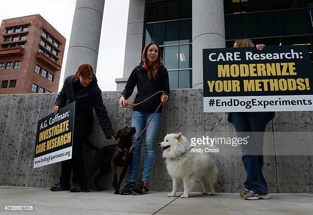 Dog supporters Britton Slagle left Aubyn Royal and her dog Athena center and Marie Douglas with her dog Liam attend a protest sponsored by the...