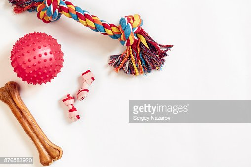 Dog toys set: colorful cotton dog toy and pink ball on a white background : Stock Photo