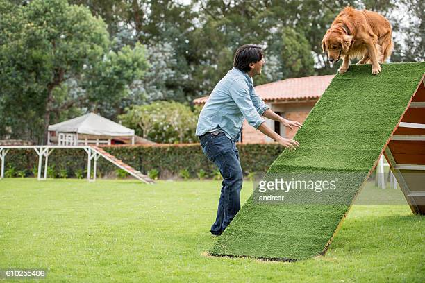 Dog trainer at an obstacle course