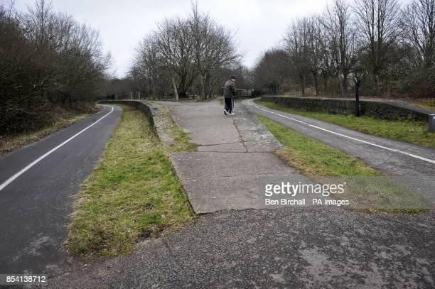 A dog walker heads towards the station platforms at Mangotsfield station on the Bristol Bath railway path The Bristol Bath Railway Path was...