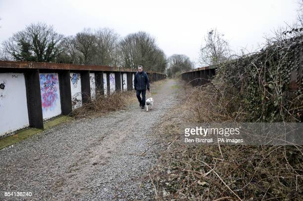 A dog walker on a gravel section on the Bristol Bath railway path The Bristol Bath Railway Path was constructed on the track bed of the former...