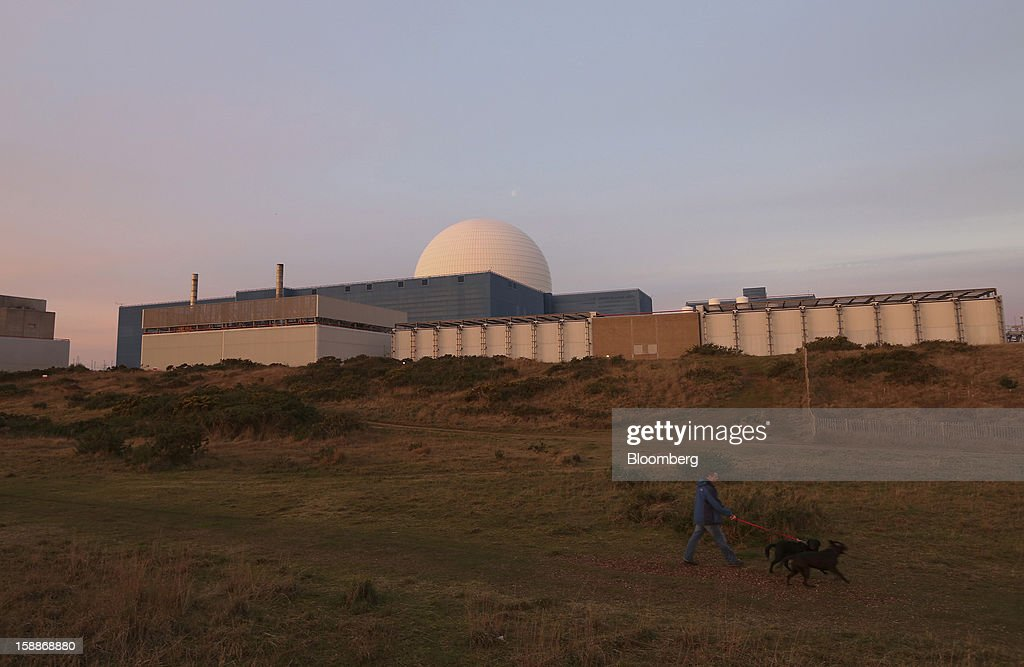A dog walker passes the reactor dome at the Sizewell B nuclear power station, operated by Electricite de France SA (EDF), in Sizewell, U.K., on Wednesday, Jan. 2, 2013. EDF operates eight U.K. atomic power stations and has proposed to add Areva reactors at its Hinkley Point and Sizewell sites. Photographer: Chris Ratcliffe/Bloomberg via Getty Images