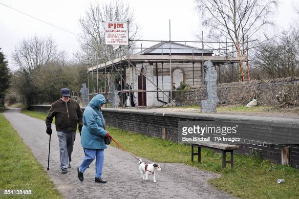Dog walkers pass renovation work to the cafe on the preserved Warmly station platform on the Bristol Bath railway path Warmly The Bristol Bath...