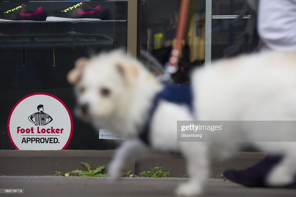 A dog walks past a Foot Locker Inc. store in San Francisco, California, U.S., on Tuesday, March 5, 2013. Foot Locker Inc. is expected to release earnings data on March 8. Photographer: David Paul Morris/Bloomberg via Getty Images