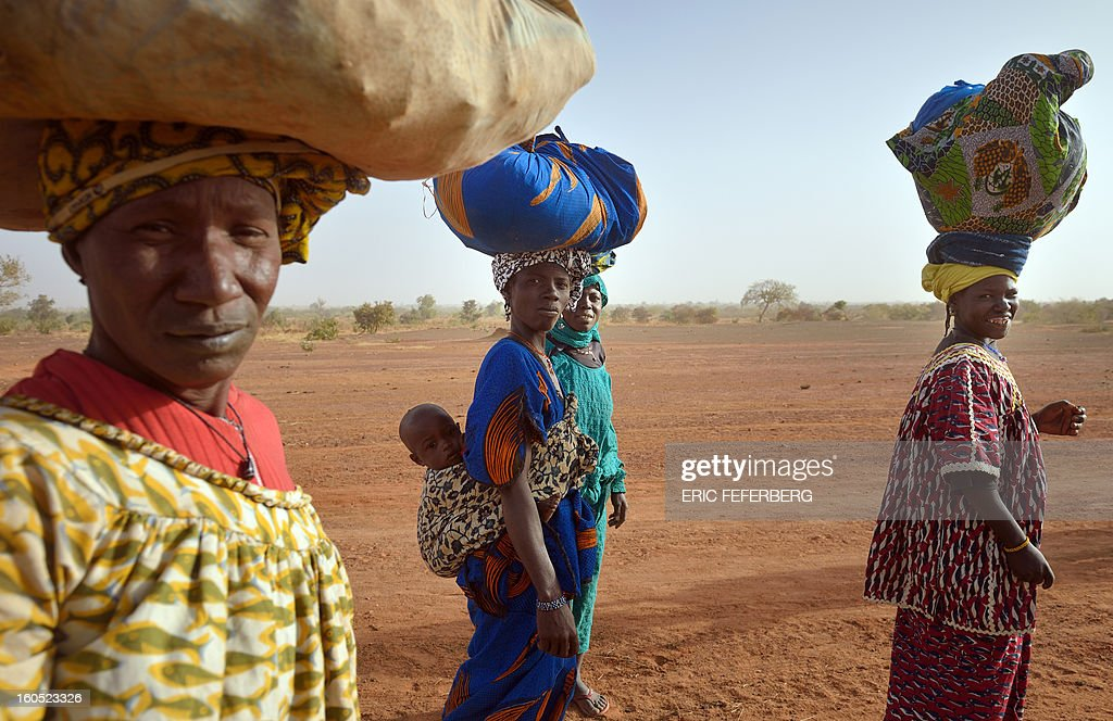 Dogon ethnic group people walk back to the village they left after Islamists arrived, on February 1, 2013 in Binta.