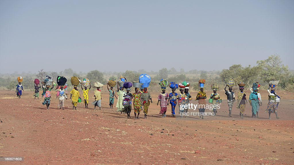 Dogon ethnic group women walk back to the village they left after Islamists arrived, on February 1, 2013 in Binta. AFP PHOTO ERIC FEFERBERG