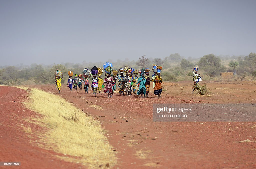 Dogon ethnic group women walk back to the village they left after Islamists arrived, on February 1, 2013 in Binta.