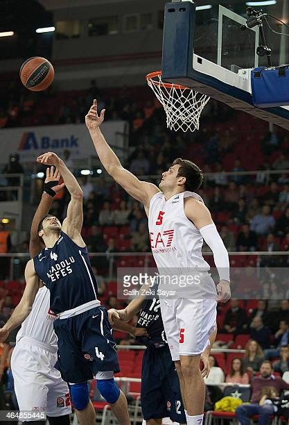 Dogus Balbay of Anadolu EFES competes with Alessandro Gentile of EA7 Emporio Armani Milan during the 20132014 Turkish Airlines Euroleague Top 16 Date...