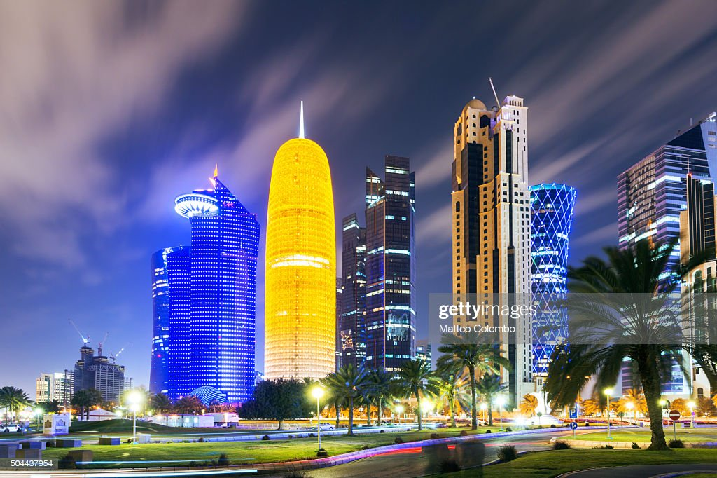 Doha city center illuminated at night, Qatar, Middle East : Stock Photo