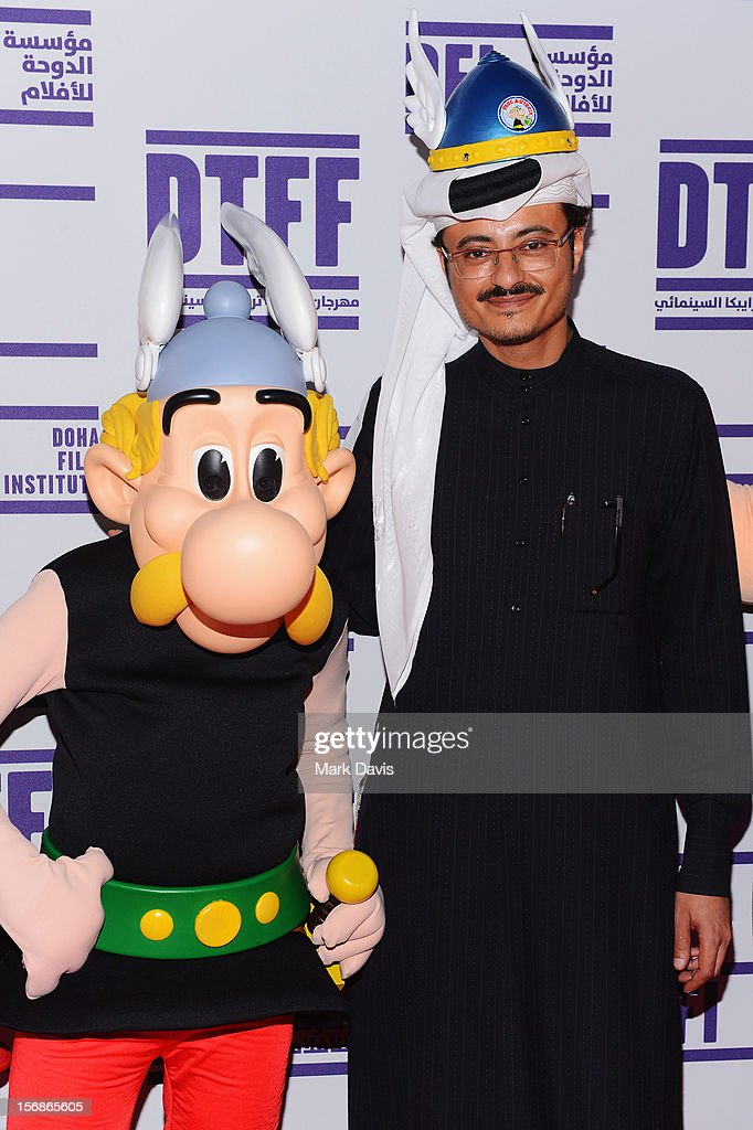 Doha Film Institute CEO Abdulaziz Bin Khalid Al-Khater (R) and Asterix at the attends the 'Asterix and Obelix 3D' Premiere during the 2012 Doha Tribeca Film Festival at on November 23, 2012 in Doha, Qatar.