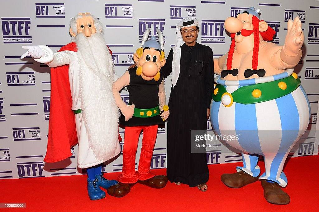 Doha Film Institute CEO Abdulaziz Bin Khalid Al-Khater (R) and Asterix, Obelix and Getafixat attend the 'Asterix and Obelix 3D' Premiere during the 2012 Doha Tribeca Film Festival at o n November 23, 2012 in Doha, Qatar.