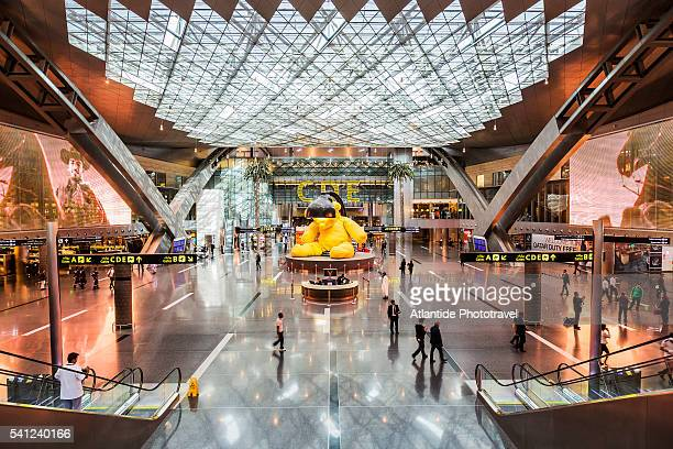 Doha International Airport, the interior and the sculpture Lamp Bear by Urs Fischer