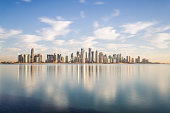 Doha modern city reflected in the sea, Qatar