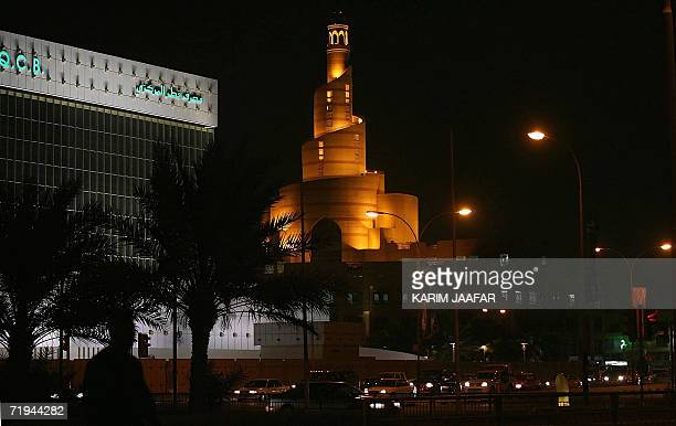 A general view of central Doha at night shows the building of the ministry of religious endowments 15 September 2006 on the capital's corniche with...