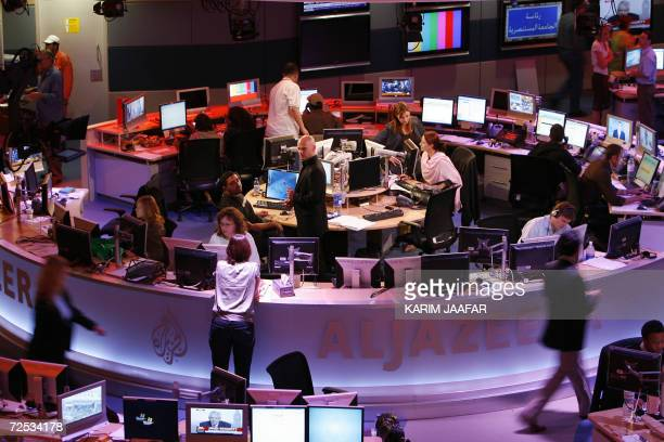 A general view shows the newsroom at the headquarters of the Qatarbased AlJazeera satellite news channel in Doha 14 November 2006 The Englishlanguage...