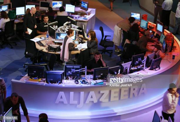 A general view shows the newsroom at the headquarters of the Qatarbased AlJazeera satellite channel in Doha 14 November 2006 The Englishlanguage...