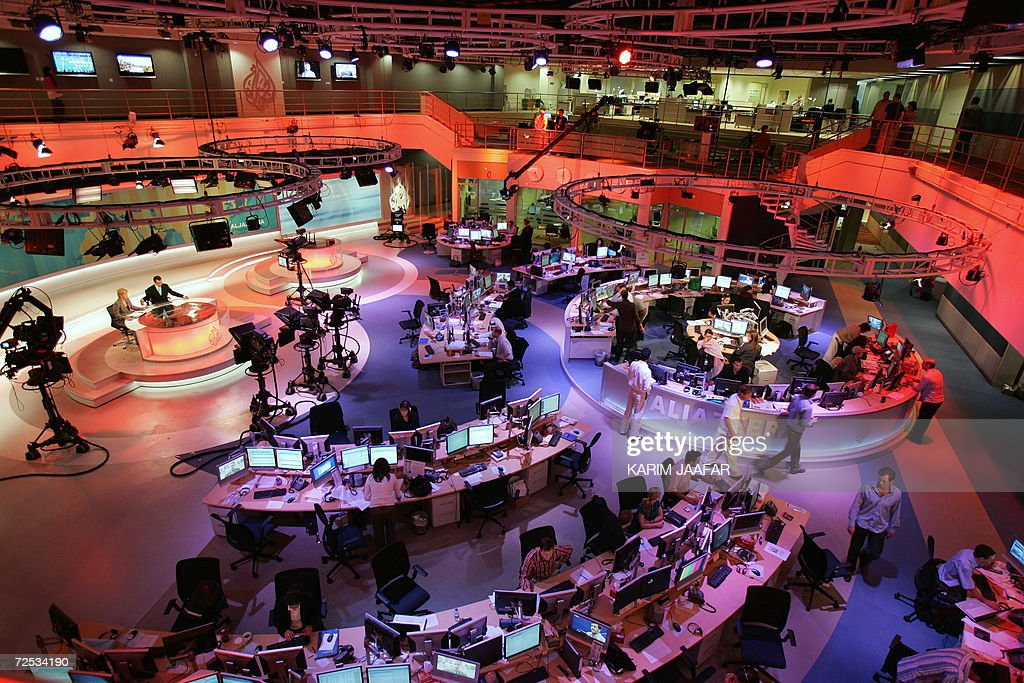 A general view shows the newsroom at the headquarters of the Qatar-based Al-Jazeera satellite news channel in Doha 14 November 2006. The English-language version of Al-Jazeera's launches 15 November 2006 after a year-long delay. The pan-Arab TV station is out to capitalise on the strategic importance of London as a European capital when it kicks off its English-language service tomorrow. AFP PHOTO/KARIM JAAFAR