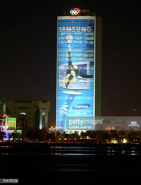 A huge portrait of an athlete in action adorns the Qatar Olympic Committee building in Doha 07 November 2006 For Qatar the Games is a onceinalifetime...
