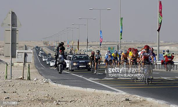 A peloton of cyclists jostle for position on the road to alKhor during of the women's road race during the 15th Asian Games in Doha 04 December 2006...