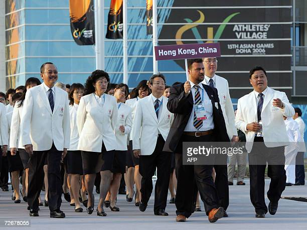 Athletes from Hong Kong arrive for their welcoming ceremony in the athletes village at the 15th Asian Games in Doha 30 November 2006 one day before...