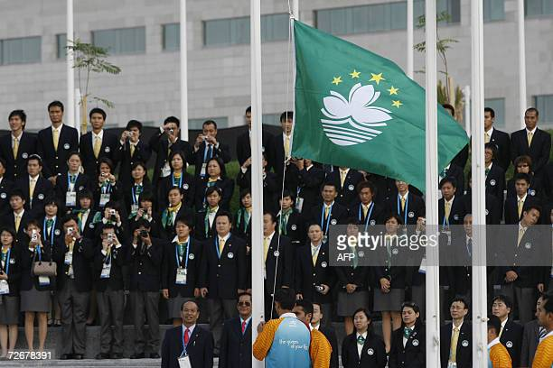 Athletes from Macau attend their welcoming ceremony in the athletes village at the 15th Asian Games in Doha 30 November 2006 one day before the games...