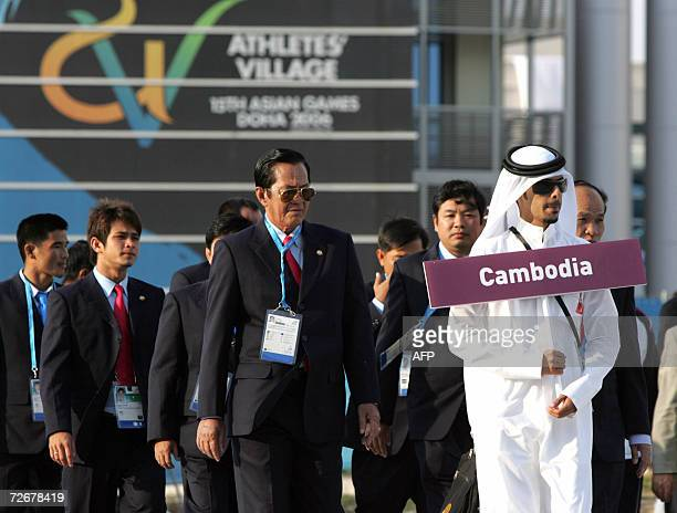Cambodian athletes attend their welcoming ceremony in the athletes village at the 15th Asian Games in Doha 30 November 2006 one day before the games...
