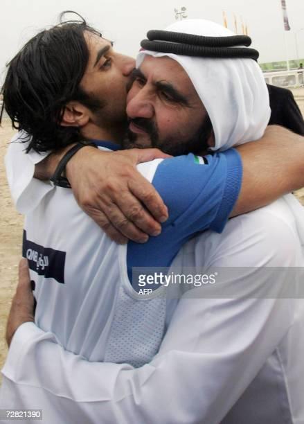 Dubai ruler Sheikh Mohammed Bin Rashid Al Maktoum hugs his son Sheikh Rashid Bin Mohammed al Makhtoum who finished first in the equestrian endurance...
