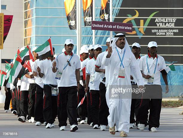 Emirati athletes attend their welcoming ceremony in the athletes village at the 15th Asian Games in Doha 30 November 2006 one day before the games...
