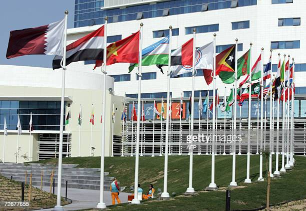 Flags from the 45 participating countries at the 15th Asian Games in Doha fly at the athletes village 30 November 2006 one day before the games...