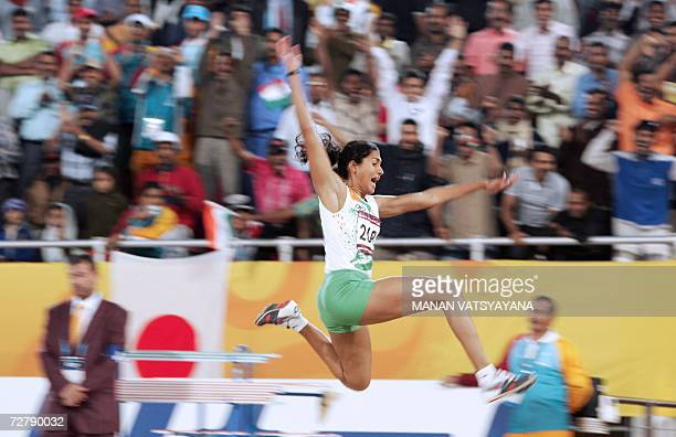 India's Anju Bobby George makes an attempt in the women's long jump final on the third day of the athletics competition for the 15th Asian Games at...