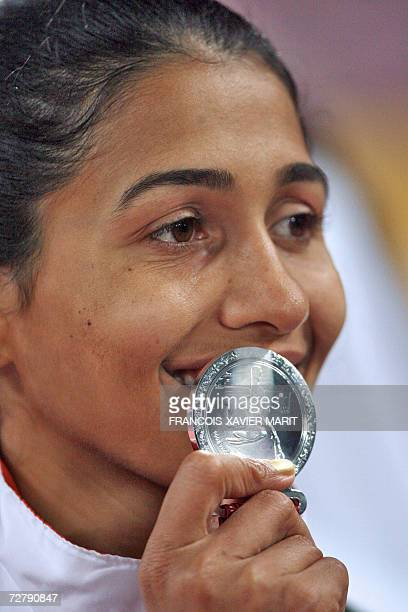 India's Anju Bobby George poses with her silver medal after the women's long jump final on the third day of the athletics competition for the 15th...