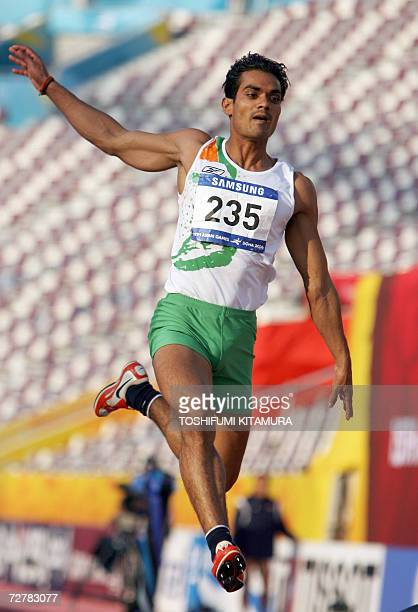 India's Shiv Shankar Yadav makes an attempt in the men's long jump final on the second day of the athletics competition for the 15th Asian Games at...