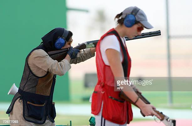 Iranian shooter Nahla Abou Mansour and Lebanese shooter Ray Bassil attend a trap training session 30 November 2006 one day before the 15th Asian...