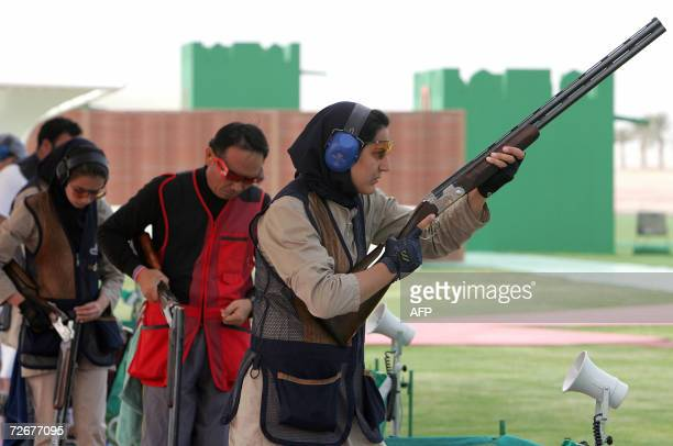 Iranian shooter Nahla Abou Mansour attends a trap training session 30 November 2006 one day before the 15th Asian Games officially open More than...
