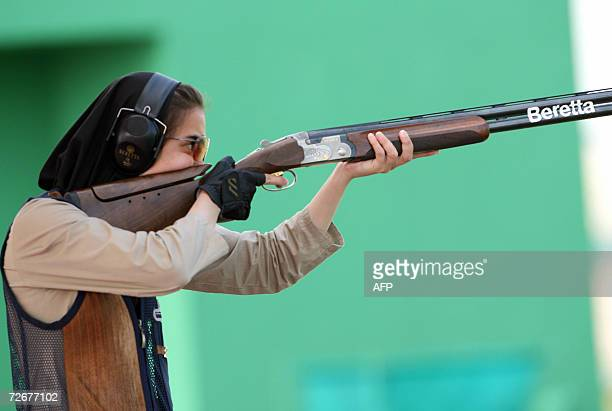 Iranian women shooter Sepideh Sirani participates in a trap training session 30 November 2006 one day before the 15th Asian Games officially open...